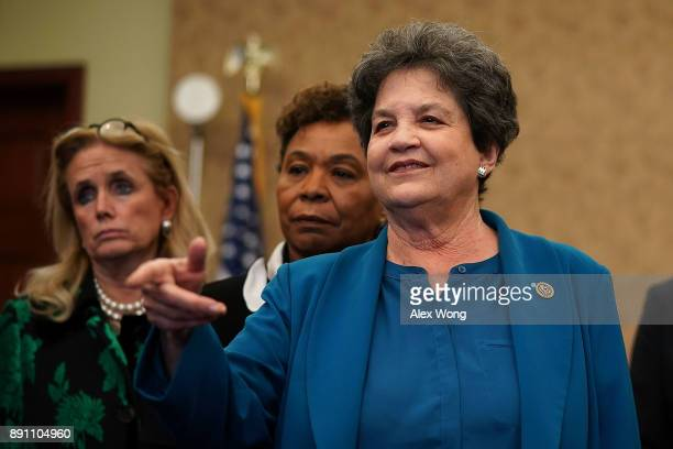 S Rep Lois Frankel speaks as Rep Barbara Lee and Rep Debbie Dingell listen during a news conference December 12 2017 on Capitol Hill in Washington DC...