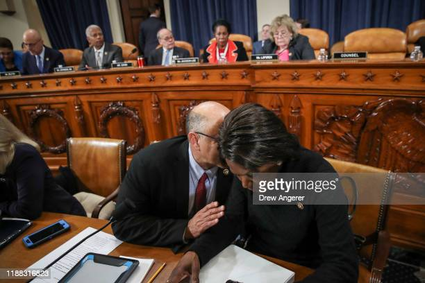 Rep. Lou Correa talks with Rep. Val Demings as they arrive for a House Judiciary Committee public hearing to vote on the two articles of impeachment...
