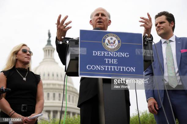 Rep. Louie Gohmert speaks as Rep. Marjorie Taylor Greene and Rep. Matt Gaetz listen during a news conference outside the U.S. Capitol July 29, 2021...