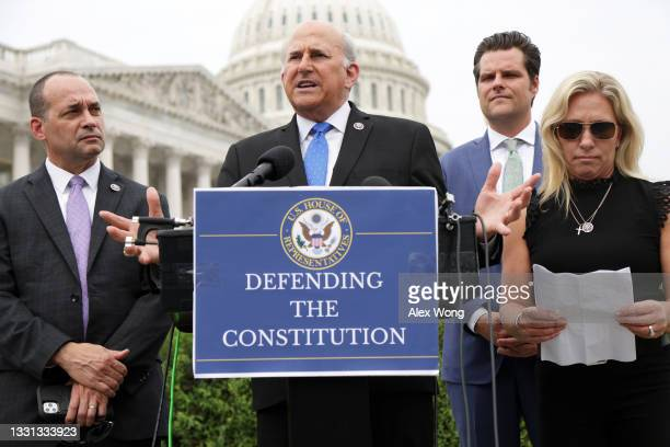 Rep. Louie Gohmert speaks as Rep. Marjorie Taylor Greene , Rep. Matt Gaetz and Rep. Bob Good listen during a news conference outside the U.S. Capitol...