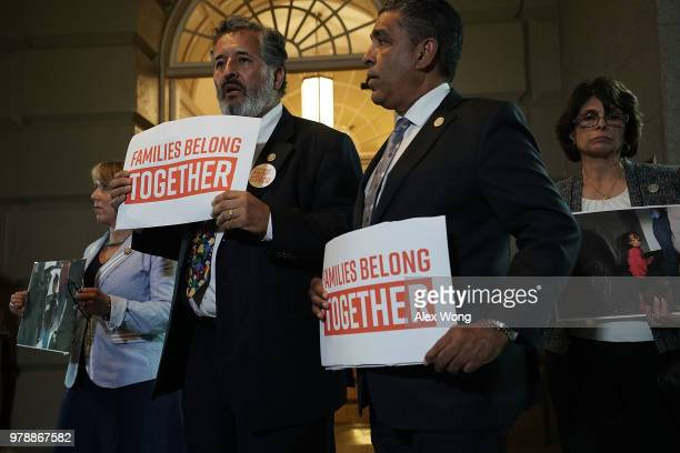 US Rep Lucille RoybalAllard Rep Adriano Espaillat Rep Juan Vargas and Rep Michelle Lujan Grisham hold signs as they stage a protest outside a meeting...
