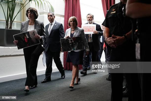 US Rep Lucille RoybalAllard Rep Adriano Espaillat Rep Michelle Lujan Grisham Rep Juan Vargas hold signs as they stage a protest outside a meeting...