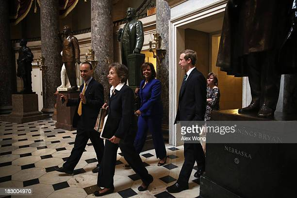 S Rep Luis Gutierrez and Rep Jan Schakowsky pass through the Statuary Hall at the Capitol October 3 2013 on Capitol Hill in Washington DC The House...