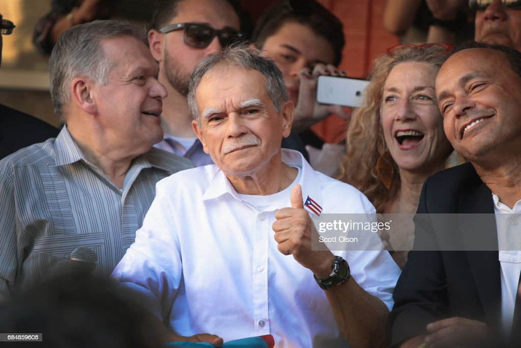U.S. Rep. Luis Gutierrez (R) (D-IL) listens as Puerto Rican nationalist Oscar López Rivera (C) speaks to supporters during a rally on May 18, 2017 in Chicago, Illinois. López, who once lived in Chicago was released from federal custody yesterday, his prison sentence being commuted by President Barack Obama before he left office. Lopez was one of the leaders of the Armed Forces of National Liberation (FALN), a Puerto Rican group that claimed responsibility for more than 100 bombings at government buildings, department stores, banks and restaurants in New York, Chicago, Washington D.C. and Puerto Rico during the 1970s and early 1980s.