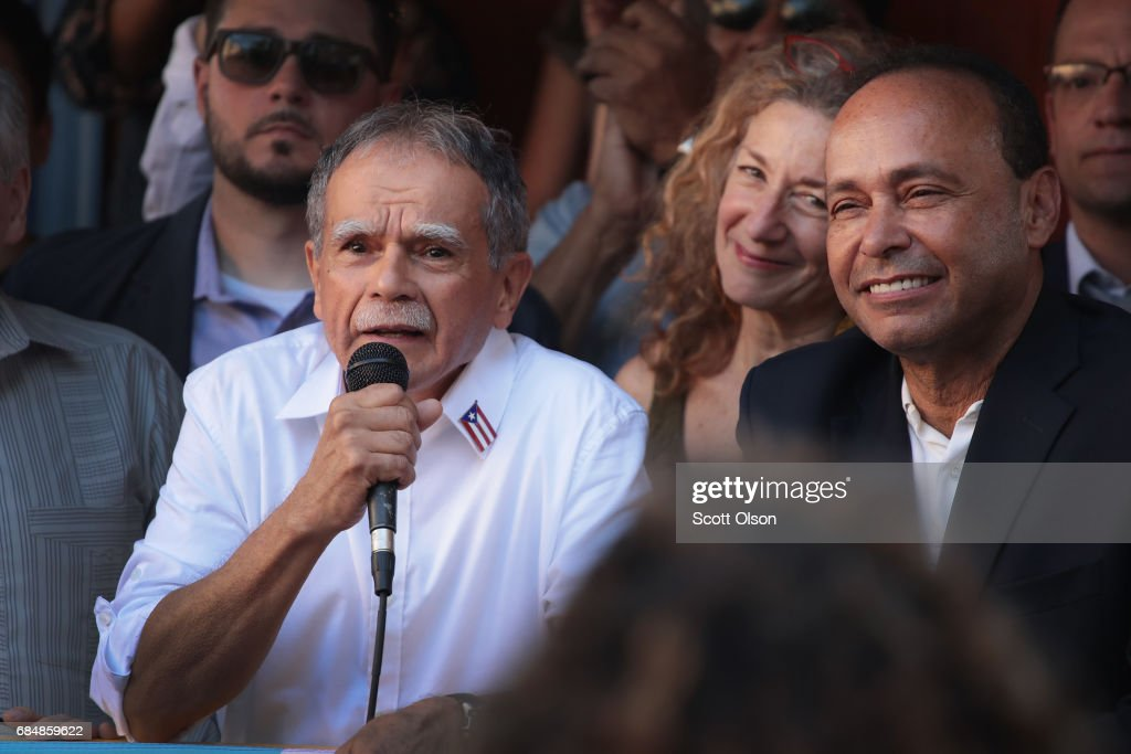 U.S. Rep. Luis Gutierrez (R) (D-IL) listens as Puerto Rican nationalist Oscar López Rivera speaks to supporters during a rally on May 18, 2017 in Chicago, Illinois. López, who once lived in Chicago was released from federal custody yesterday, his prison sentence being commuted by President Barack Obama before he left office. Lopez was one of the leaders of the Armed Forces of National Liberation (FALN), a Puerto Rican group that claimed responsibility for more than 100 bombings at government buildings, department stores, banks and restaurants in New York, Chicago, Washington D.C. and Puerto Rico during the 1970s and early 1980s.
