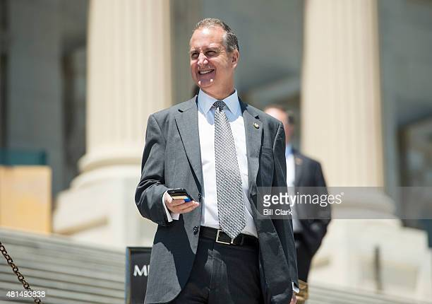 Rep Mario DiazBalart RFla walks down the House steps following the final vote of the week on Thursday July 16 2015