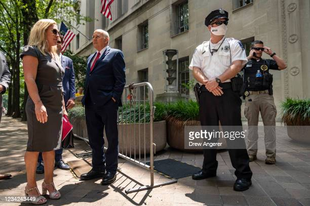 Rep. Marjorie Taylor Greene and Rep. Louie Gohmert unsuccessfully try to gain entry to the U.S. Department of Justice on July 27, 2021 in Washington,...