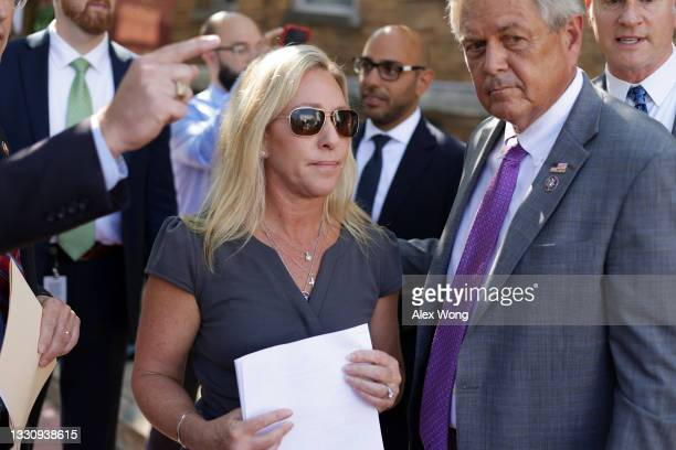 Rep. Marjorie Taylor Greene and Rep. Ralph Norman attend a news conference outside U.S. Supreme Court on July 27, 2021 in Washington, DC. The...