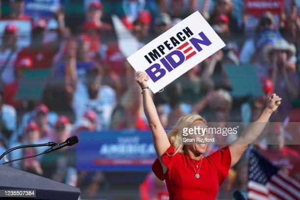 Rep. Marjorie Taylor Greene holds a sign that reads Impeach Biden at a rally featuring former US President Donald Trump on September 25, 2021 in...