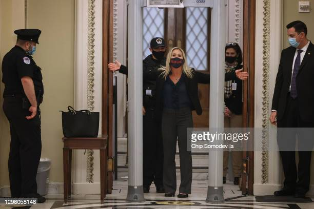 Rep. Marjorie Taylor Greene is searched by U.S. Capitol Police after setting off the metal detector outside the doors to the House of Representatives...