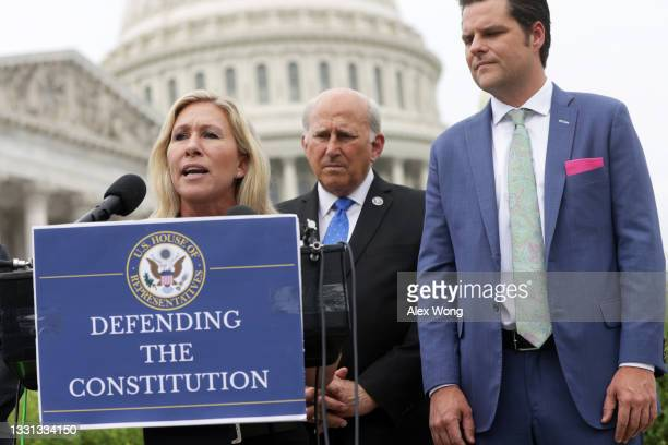 Rep. Marjorie Taylor Greene speaks as Rep. Louie Gohmert and Rep. Matt Gaetz listen during a news conference outside the U.S. Capitol July 29, 2021...