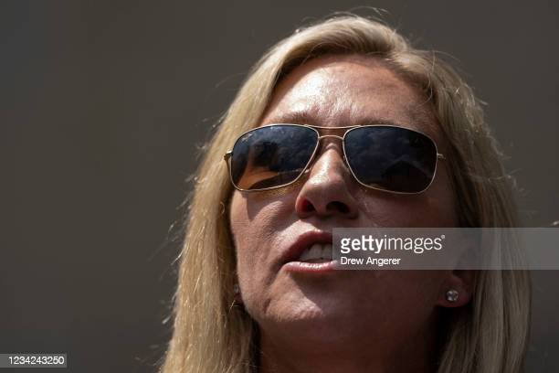 Rep. Marjorie Taylor Greene speaks during a news conference outside the U.S. Department of Justice on July 27, 2021 in Washington, DC. A group of...