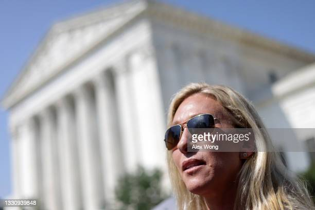 Rep. Marjorie Taylor Greene speaks to a reporter after a news conference outside U.S. Supreme Court on July 27, 2021 in Washington, DC. The...