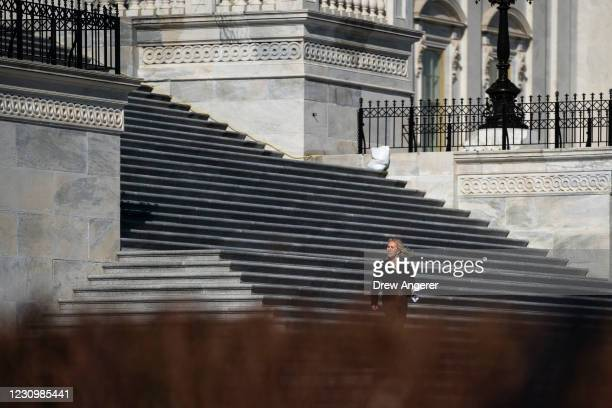 Rep. Marjorie Taylor Greene walks down the steps of the U.S. Capitol on her way to a press conference outside the U.S. Capitol on February 5, 2021 in...