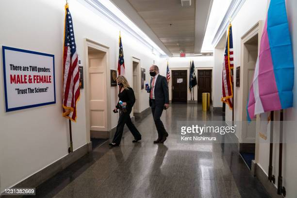 Rep. Marjorie Taylor Greene walks to her office in a hallway between the offices of Rep. Marie Newman and Rep. Marjorie Taylor Greene where Greene...