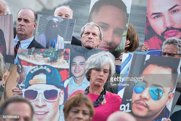 Rep Mark DeSaulnier DCalif center attends a vigil on the House steps of the Capitol at which members held up pictures of the Orlando nightclub...