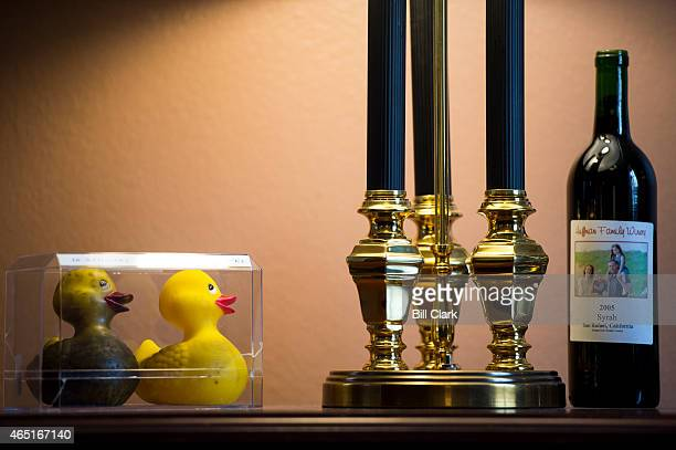Rep Mark DeSaulnier DCalif keeps a bottle of California red wine and two rubber ducks in his office in the Cannon House Office Building on Tuesday...