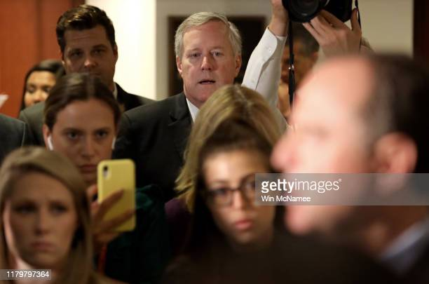 Rep Mark Meadows Chairman of the Freedom Caucus listens as Rep Adam Schiff Chairman of the House Select Committee on Intelligence Committee speaks at...