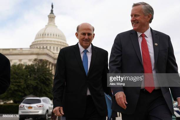 S Rep Mark Meadows leaves with Rep Louie Gohmert after a news conference in front of the Capitol December 6 2017 in Washington DC Rep Matt Gaetz held...