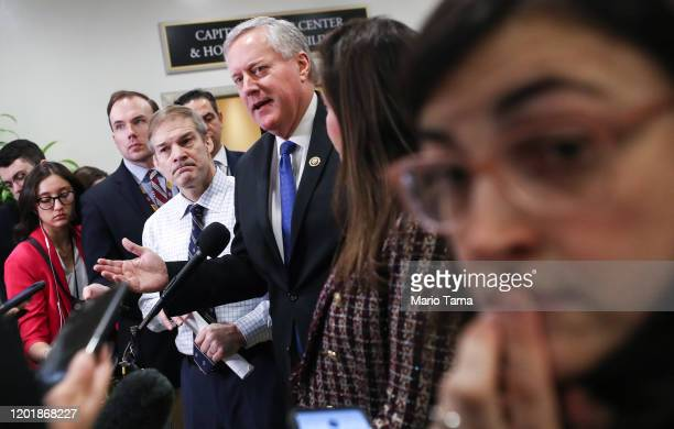Rep Mark Meadows LEFT C speaks to the media as Rep Jim Jordan 4th L looks on at a news conference about impeachment trial proceedings against...
