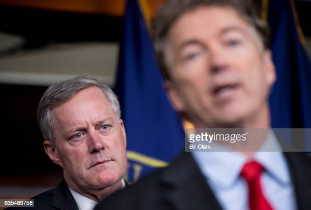 Rep Mark Meadows RNC chair of the House Freedom Caucus listens as Sen Rand Paul RKy speaks during the news conference on Affordable Care Act...