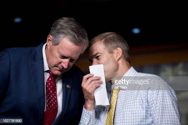 Rep Mark Meadows RNC left and Rep Jim Jordan ROhio talk during the press conference calling on President Trump to declassify the Carter Page FISA...