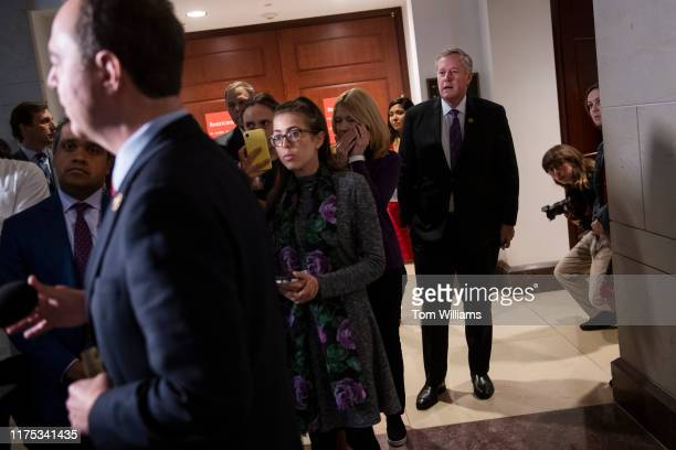 Rep Mark Meadows RNC right listens to House Intelligence Chairman Adam Schiff DCalif outside a meeting in the Capitol Visitor Center where Gordon...