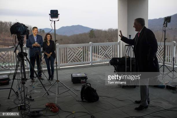 Rep Mark Meadows RNC right talks with Rep Sean Duffy RWis and his wife Rachel CamposDuffy at the media center during House and Senate Republican...