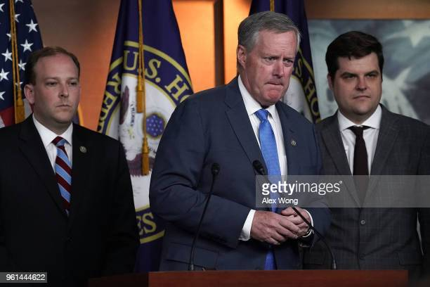 S Rep Mark Meadows speaks as Rep Lee Zeldin and Rep Matt Gaetz listen during a news conference May 22 2018 on Capitol Hill in Washington DC Rep...