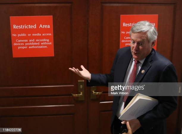 Rep Mark Meadows speaks to reporters before entering a closeddoor deposition on Capitol Hill October 29 2019 in Washington DC Army Lt Col Alexander...