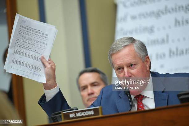 Rep Mark Meadowsholds up a paper as Michael Cohen US President Donald Trump's former personal attorney testifies before the House Oversight and...