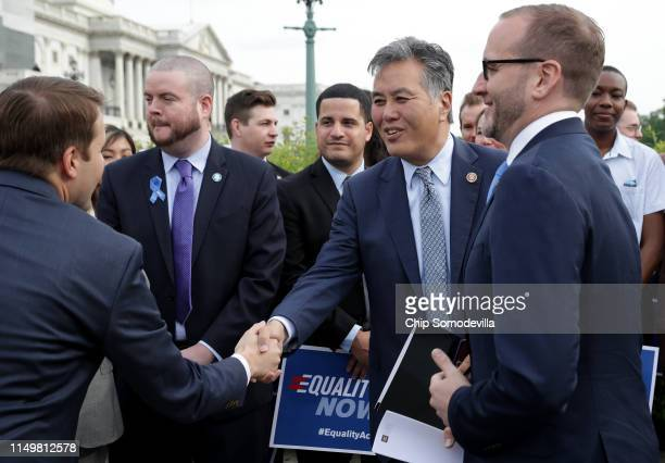 Rep Mark Takano greets Rep Chris Pappas during a rally and news conference with Human Rights Campaign President Chad Griffin and other leaders from...