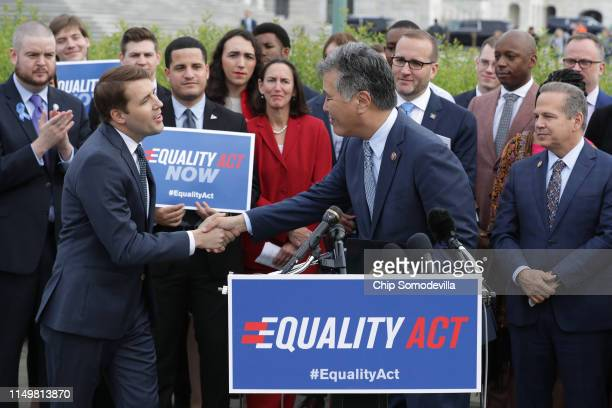 Rep Mark Takano welcomes Rep Chris Pappas to the lectern during a rally and news conference with Rep David Cicilline and leaders from LGBTQ advocacy...