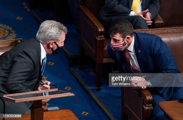 Rep. Markwayne Mullin, R-Okla., right, and House Minority Leader Kevin McCarthy, R-Calif., attend a joint session of Congress to certify the...