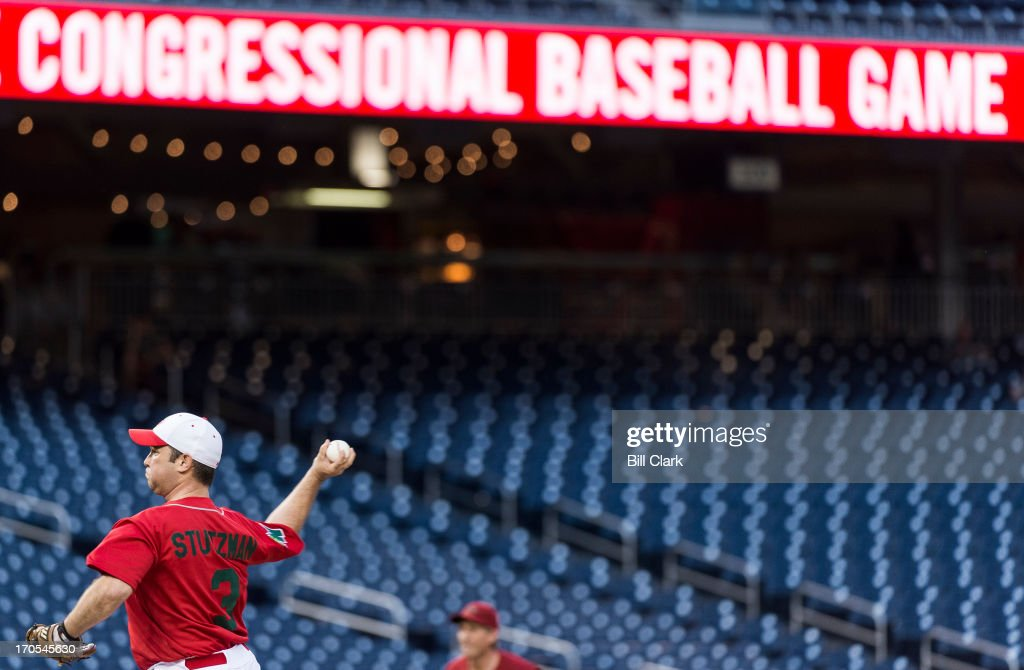 Rep. Marlin Stutzman, R-Ind., pitches during the 52nd annual Congressional Baseball Game at national Stadium in Washington on Thursday, June 13, 2013.