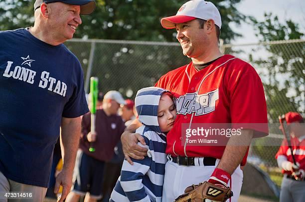 Rep Marlin Stutzman RInd right his son Preston and Rep Kevin Brady RTexas attend Republican baseball practice in Alexandria Va May 14 2015