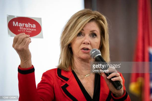 S Rep Marsha Blackburn Republican candidate for US Senate encourages supporters to put bumper stickers on their cars during a getoutthevote rally at...