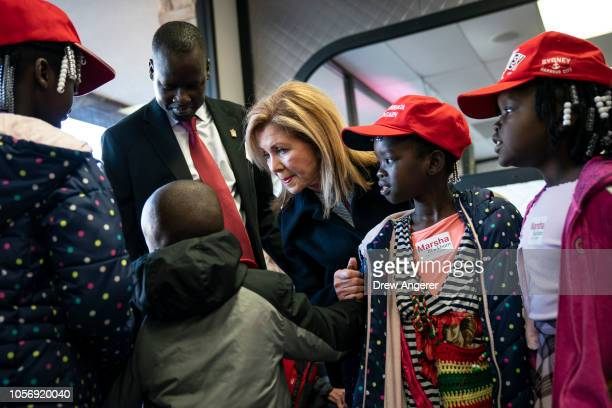 S Rep Marsha Blackburn Republican candidate for US Senate talks with a family during a volunteer thank you breakfast at Fox's Donut Den November 3...