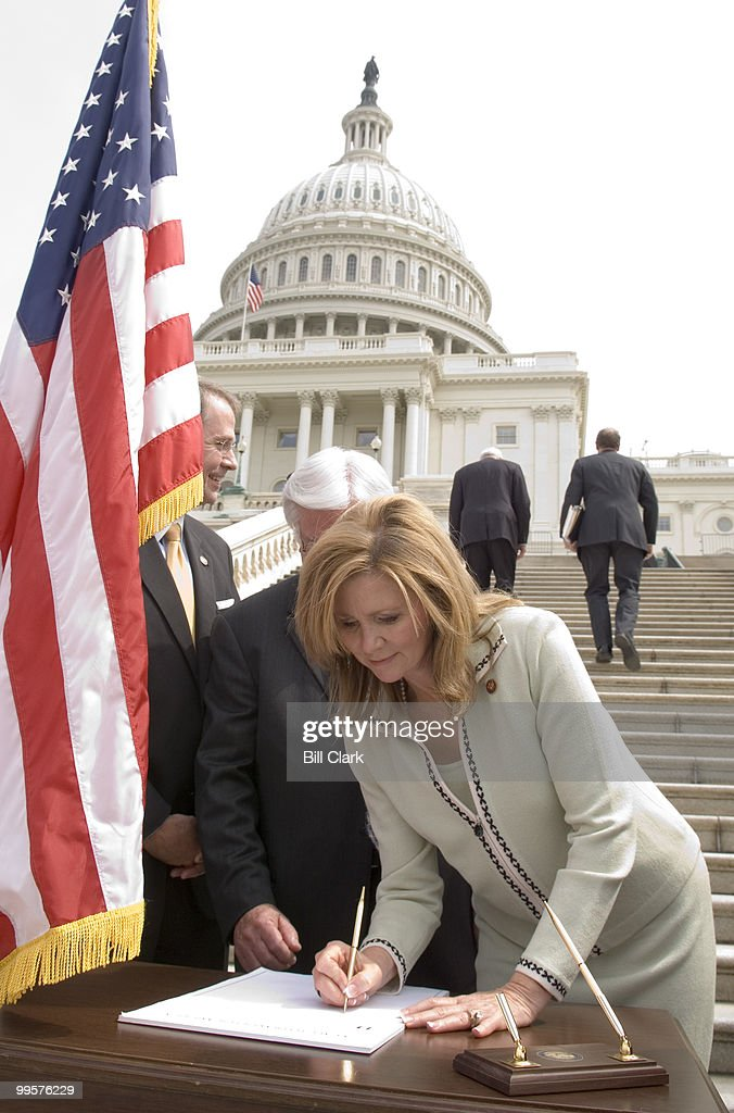 Rep. Marsha Blackburn, R-Tenn., signs the pledge to pray for the nation at the conclusion of the news conference to 'officially call America back to prayer and encourage people to sign up to pray for our nation for five minutes each week,' on the steps of the West Front of the Capitol on Wednesday, March 28, 2007. The event was forced to relocate away from the West Front due to a suspicious package found in the area, but the area was reopened in time for members to sign the pledge.