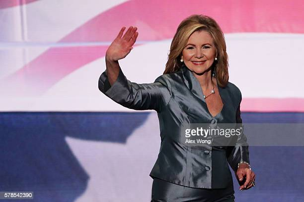 Rep Marsha Blackburn waves to the crowd as she walks on stage to deliver a speech during the evening session on the fourth day of the Republican...
