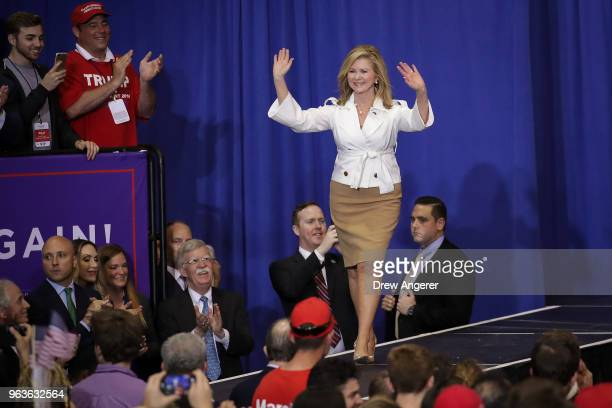 Rep Marsha Blackburn who is running for US Senate arrives for a rally with US President Donald Trump at the Nashville Municipal Auditorium May 29...