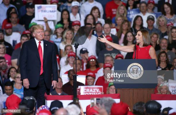 Rep Martha McSally RAriz gestures to President Donald Trump during a rally at the International Air Response facility on October 19 2018 in Mesa...