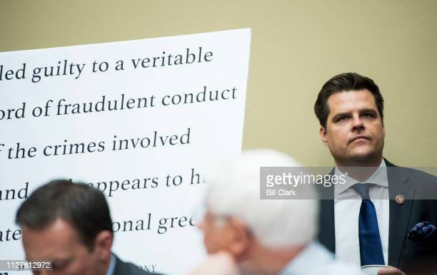 Rep Matt Gaetz RFla watches as Michael Cohen former attorney for President Donald Trump testifyies during the House Oversight and Reform Committee...