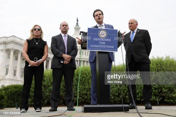Rep. Matt Gaetz speaks as Rep. Marjorie Taylor Greene , Rep. Louie Gohmert and Rep. Bob Good listen during a news conference outside the U.S. Capitol...
