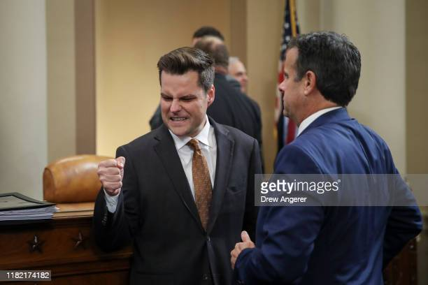 Rep Matt Gaetz speaks top Rep John Ratcliffe at the conclusion of testimony from top US diplomat in Ukraine William B Taylor and Deputy Assistant...