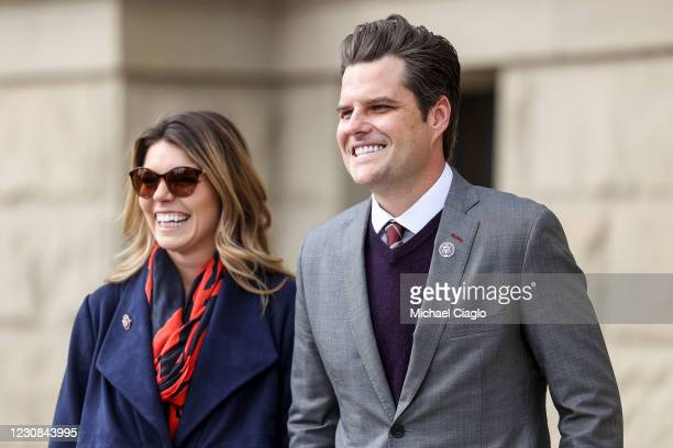 Rep. Matt Gaetz walks with his fiancee Ginger Luckey before speaking to a crowd during a rally against Rep. Liz Cheney on January 28, 2021 in...