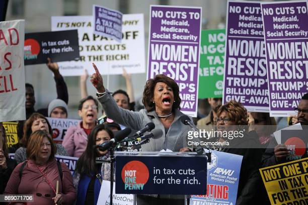 Rep Maxine Waters addresses a rally against the Republican tax plan outside the US Capitol November 1 2017 in Washington DC The rally was organized...