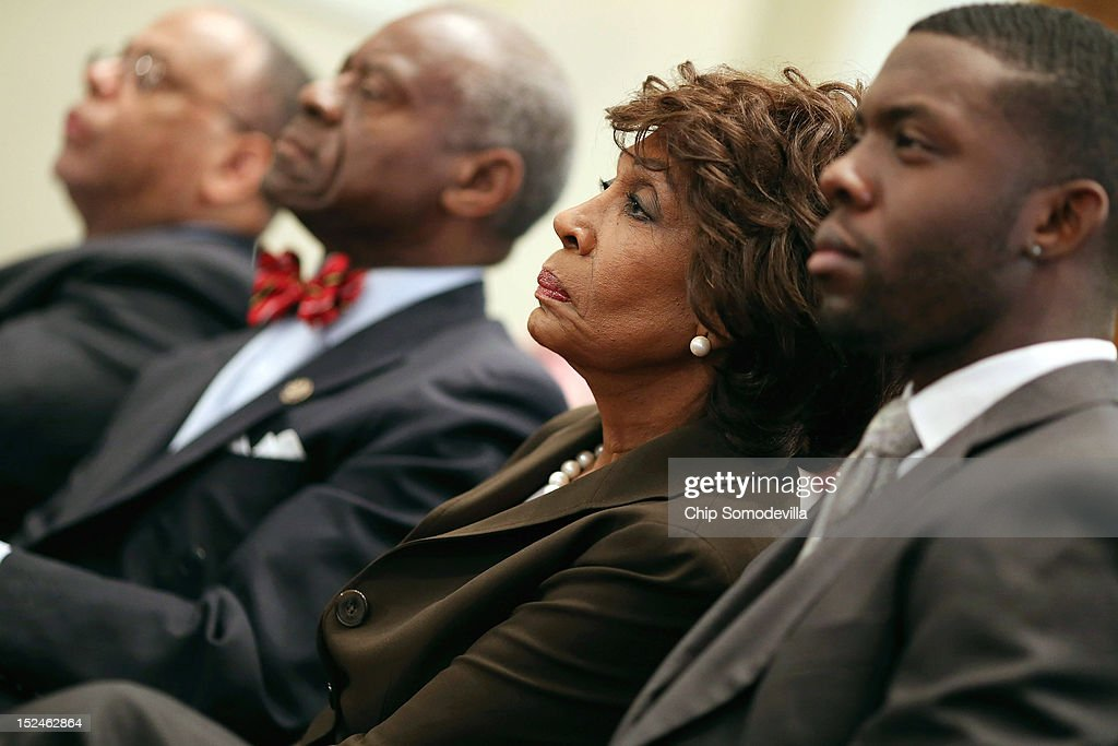 Rep. Maxine Waters (D-CA) (2nd R) and her husband Sidney Williams (2nd L) listen to opening statements during a rare open House Committee on Ethics hearing in the Longworth House Office Building on Capitol Hill September 21, 2012 in Washington, DC. A long-running investigation found that Waters did not commit an ethics violaiton when her office in late 2008 set up a meeting with top Treasury Department officials on behalf of a bank Williams owned stock in, at a time when the bank faced possible collapse because of the financial crisis. However, Waters' Chief of Staff and grandson, Mikael Moore, was issued a letter of reproval for three ethics violations for helping the bank.