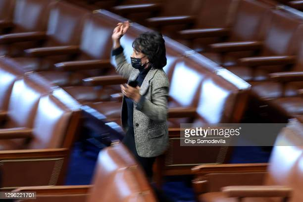 Rep. Maxine Waters races into the House Chamber to cast the last vote to impeach U.S. President Donald Trump for the second time in little over a...