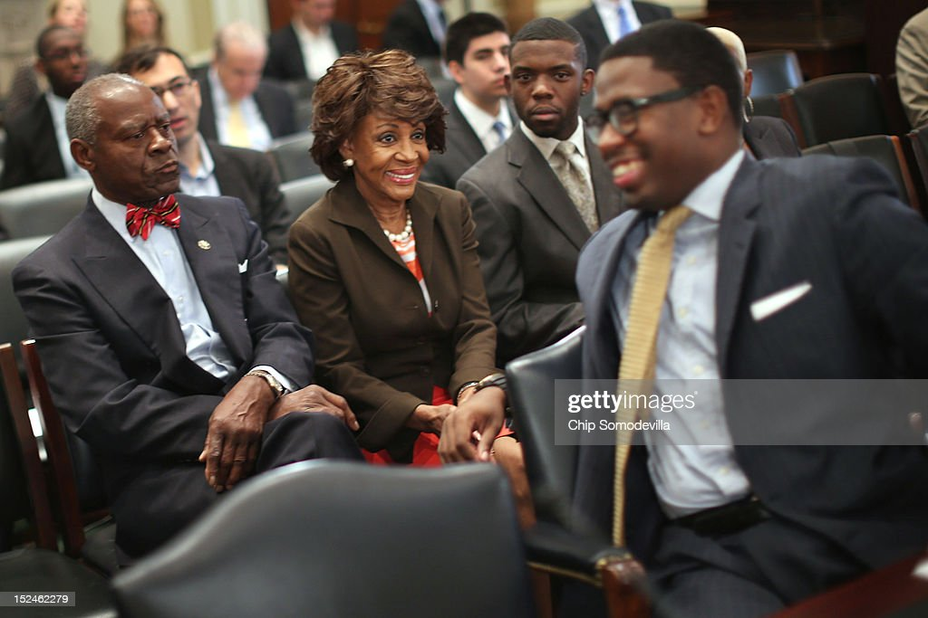 Rep. Maxine Waters (D-CA) (C) shares a laugh with her grandson and Chief of Staff Mikael Moore (R) before the start of a rare open House Committee on Ethics hearing in the Longworth House Office Building on Capitol Hill September 21, 2012 in Washington, DC. Waters' husband Sidney Williams is at left. The long-running ethics investigation found that Waters did not commit an ethics violaiton when her office in late 2008 set up a meeting with top Treasury Department officials on behalf of a bank Williams owned stock in, at a time when the bank faced possible collapse because of the financial crisis. However, Moore was issued a letter of reproval for three ethics violations for helping the bank.